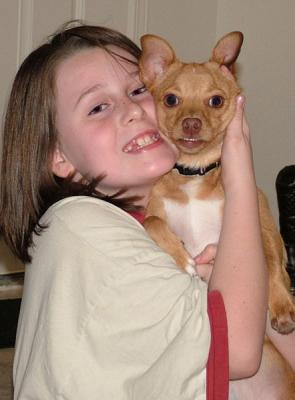A Child And Her Dog