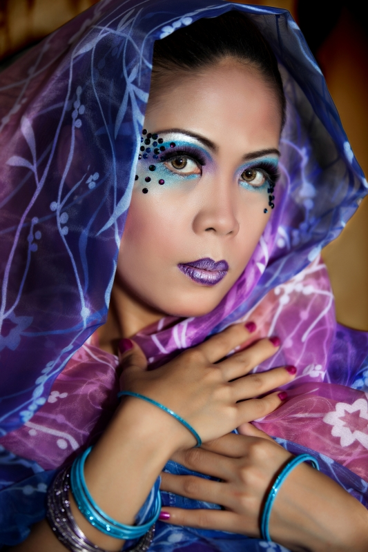 Beautiful Female Wearing A Colorful Veil