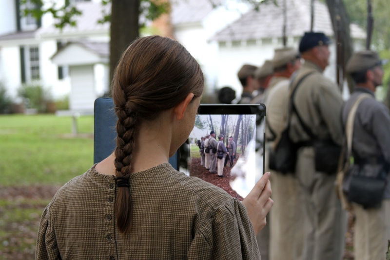 Civil War Girl Taking Picture With An Ipad