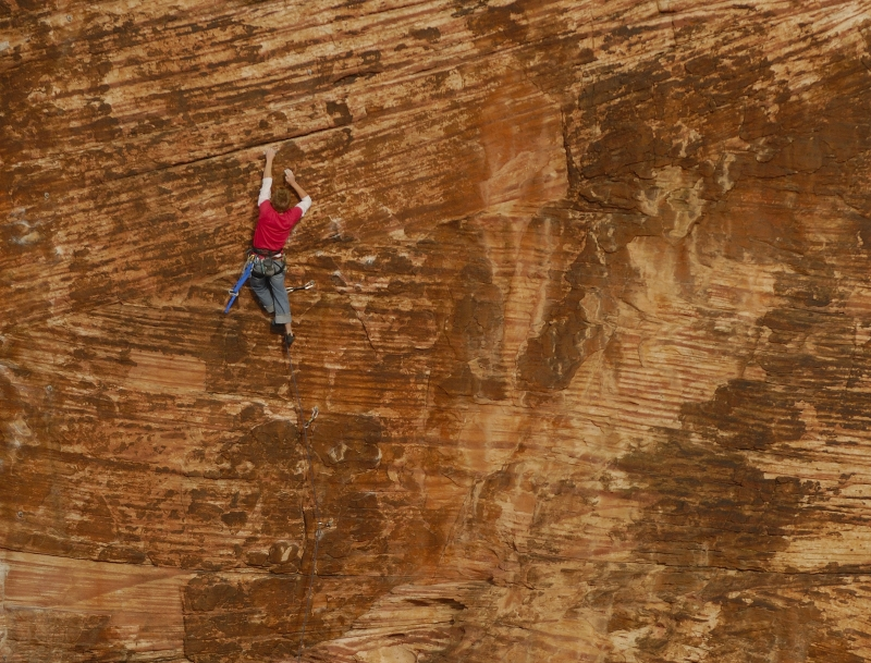 Climber On The Wall Of Red Rock Canyon