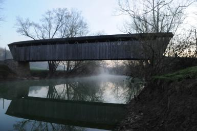 Covered Bridge On Misty Morning
