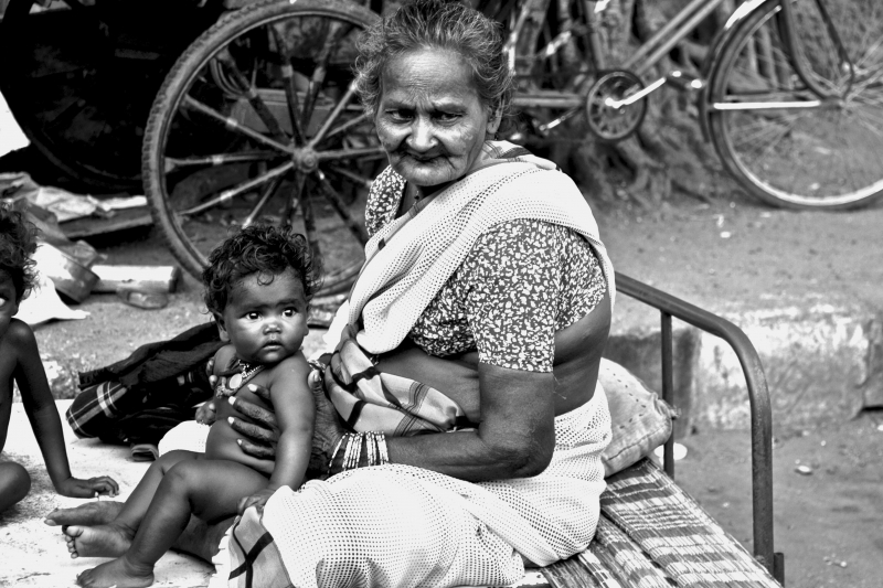 Elder And Child In The Slums