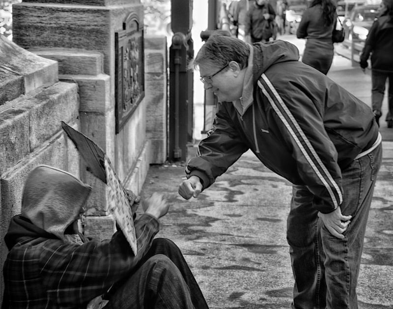 Fist Bumping A Homeless Man