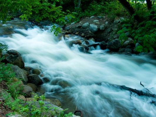 Flowing Water At Dusk