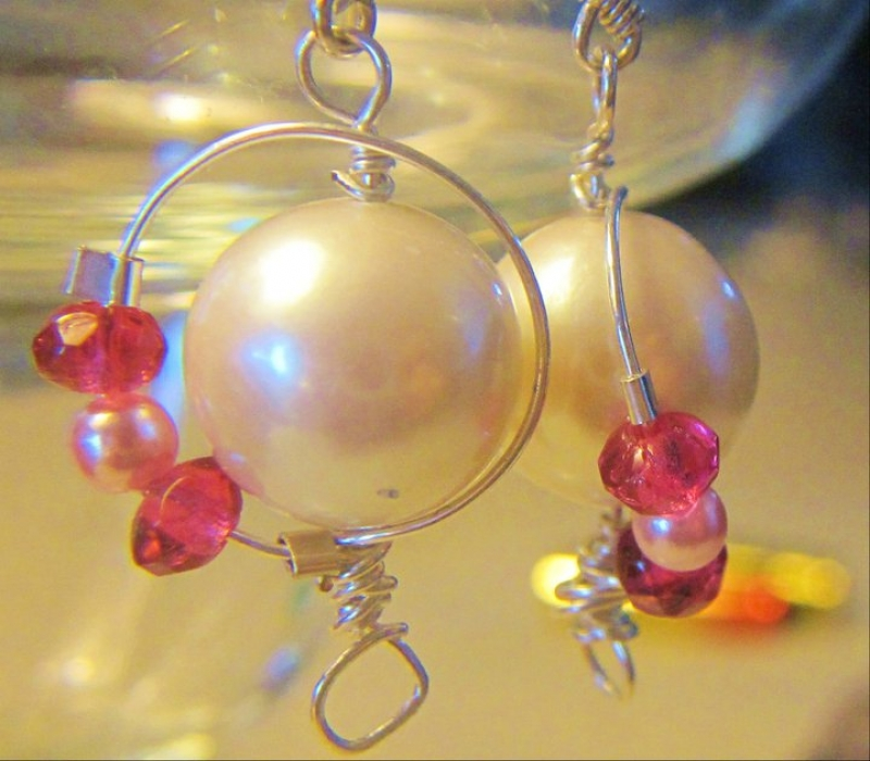 Luscious Pearls With Pink Beads Resting On A Silver Halo