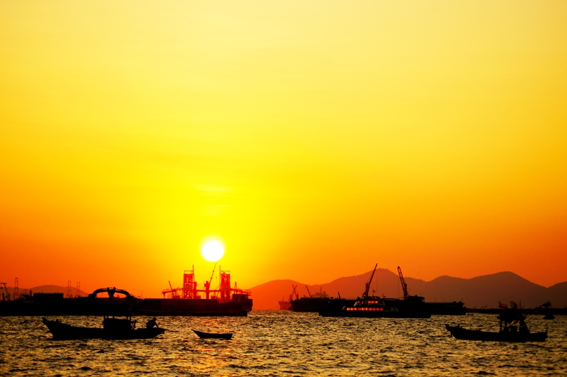 Silhouette Boats At Sunrise