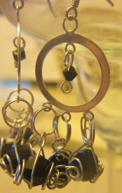 Silver Ear Rings With Caged Swarovski Balls.