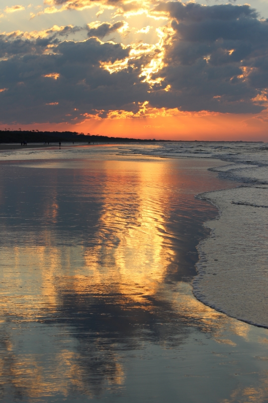 Sky Reflections On Wet Sand