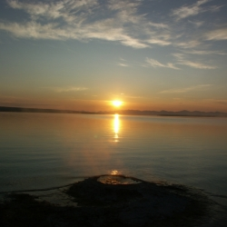 Sunrise Pointing To Geyser Cone On Yellowstone Lake