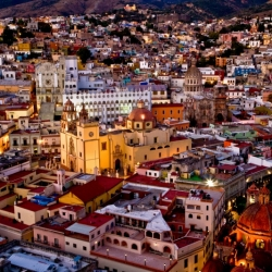 View Of Guanajuato, Mexico From Above As The Lights Come On At Dusk