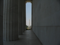 Washington Monument And The Capitol Are Framed By Columns And Wall Of Lincoln Memorial