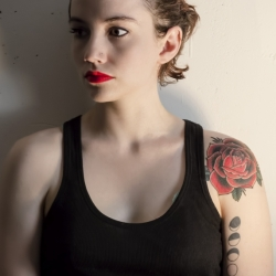 Young Woman With Red Rose Tattoo