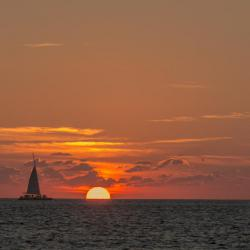 Key West, FL -  Boat at Sunset